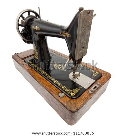 Antique Sewing Machine isolated on white with clipping path