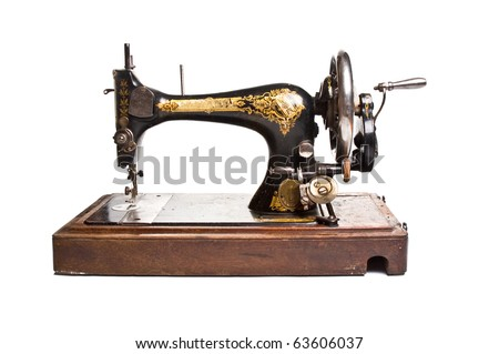 Antique sewing-machine on white background