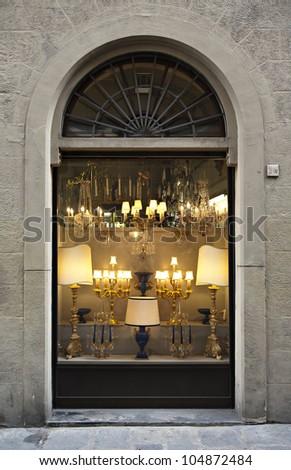 Antique shop windows full of lamps in traditional Italian shopping center in old town of Florence. Useful file for your brochure, flyer and site related to antiques store and fine-art auctions.