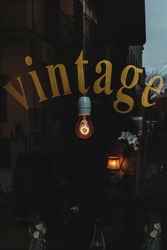 Antique Shop with a Vintage Sign and Incandescent Light Bulb.