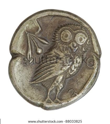Antique  silver Greek coin from Athens circa 566 BC depicting an owl image with clipping path.