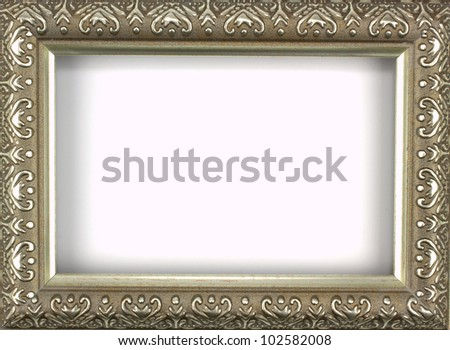 Antique silver picture frame with a decorative pattern