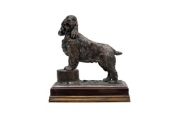 Antique Silver Statuette Dog on a stone stand on a white background. Isolated.