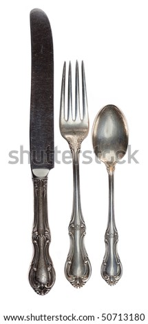 Antique silverware isolated on a white background.