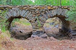 Antique Slate bridge over dry river bed