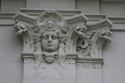 Antique stone relief of capillary column with a portrait. Facade detail