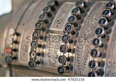 antique store silver cash register buttons close
