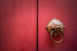 Antique style handle knocker of the Chinese temple Wooden red door with Chinese style of lion head doorknob Dragon head or lion head knocker made from brass on red wooden door,
