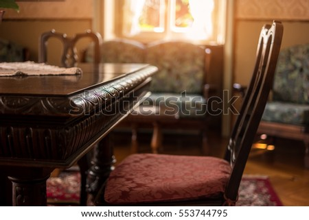 Antique table and chair. Classic room interior. Victorian furniture for sale. #553744795