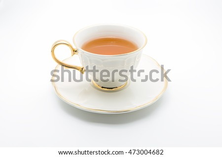 Antique tea cup full of tea on white background #473004682