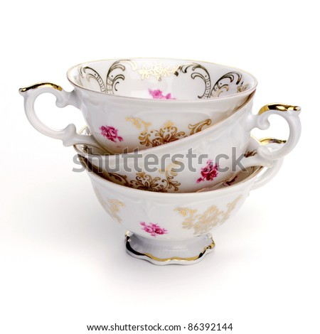 Antique tea cups on white background