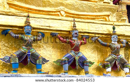 Antique Thai doll of Giant decorate around golden pagoda in Thai temple