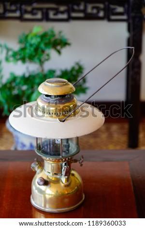 antique time-worn kerosene lamp