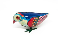 Antique tin toy blue bird isolated on white background