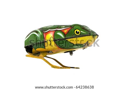 antique tin windup frog on a white background