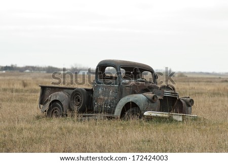 Antique Truck rusting on the prairie