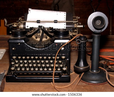 Antique typewriter and phone next to each other. #1506336