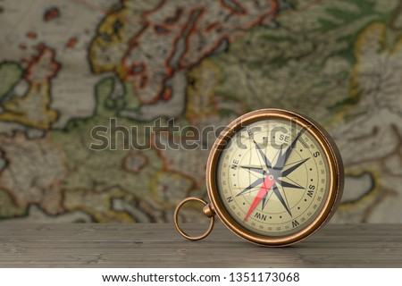 Antique Vintage Brass Compass on a Wooden Table in front of Antique Map extreme closeup. 3d Rendering