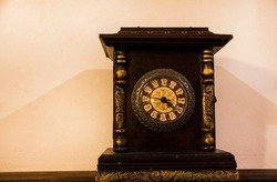Antique, vintage, mechanical clock on a white background