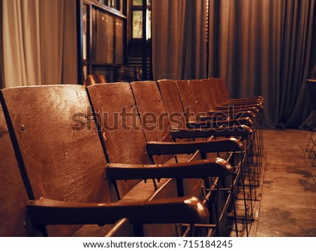 Antique vintage wooden seats in cinema or movie theater Chairs. with copy  space. - Antique Vintage Wooden Seats In Cinema Or Movie Theater Chairs. With