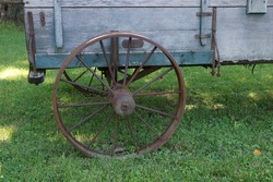 Antique wagon with rusty wheel