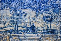 Antique wall decorated with old, Portuguese tiles or ceramic Azulejos, taken in Porto, Portugal