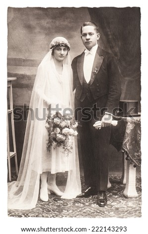 antique wedding photo. portrait of just married couple. nostalgic picture with original scratches and film grain