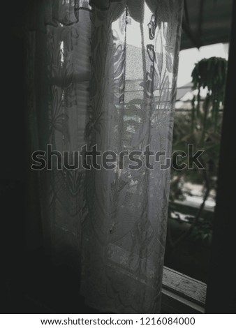 Antique window and curtain, view from the window on the old town. comfort, vintage  #1216084000