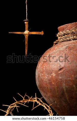 Antique wine jug and an easter cross made of rusty nails symbols of the resurrection