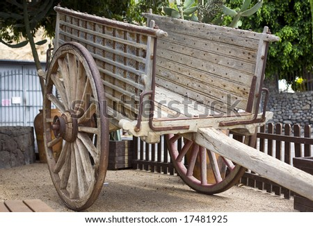 Antique wood cart with big wheels on park stock photo 17481925