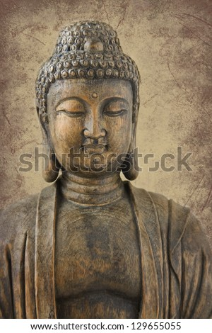Antique wood carving of Buddha, very shallow depth of field with focus on eyes; placed on sepia marbled background.