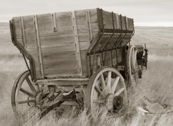 antique wood wagon in sepia tones