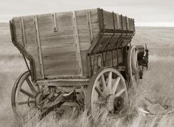 antique wood wagon in sepia tones