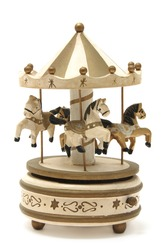antique wooden carousel on a white background