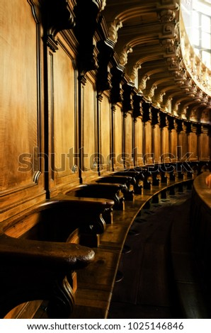 Antique wooden choir seating stalls in a baroque chapel in italy #1025146846