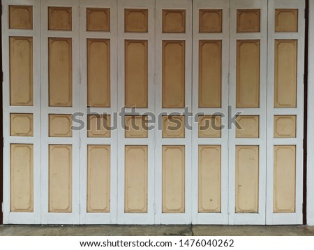 Antique wooden doors, white and cream colors and exterior architectural exterior