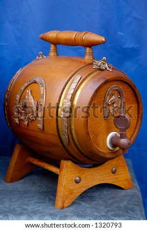 Antique wooden small draught beer keg retro object on blue background