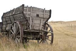 Antique wooden wagon  on the  prairie