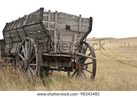 Antique wooden wagon  on the  prairie
