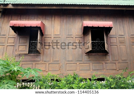 Antique wooden wall and windows with red awning of Traditional thai house