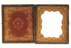 antique, worn out, clam shell photo case from nineteenth century tintype or daguerrotype portrait, red faded fabric and gold frame with floral ornaments, picture frame isolated with clipping path