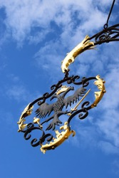 Antique wrought iron, partly gold-plated emblem with a double-headed eagle