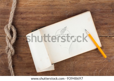 Antique 1943 year Original Old Grunge Notepad with drawing of woman portrait on wooden background