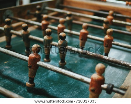 Antiques and vintage wooden Foosball soccer table.
