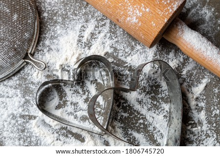 Antiques metal forms for Christmas cookies on the table with flour. Holiday cooking background Photo stock ©