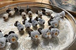 Antiques on flea market - vintage porcelain handles. Collectibles memorabilia and garage sale concept. Selective focus