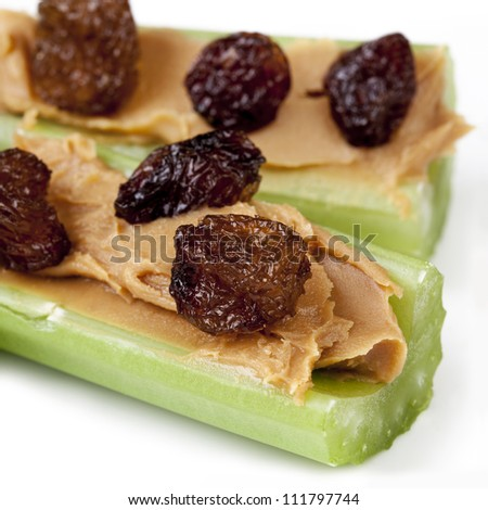 Ants on a log.  Celery sticks with peanut butter and raisins.  Healthy snacking.