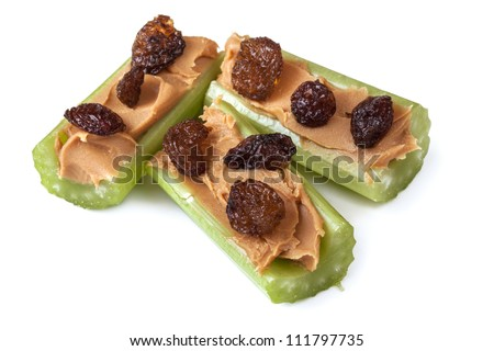 Ants on a log, celery with peanut butter and raisins, isolated on white.  Healthy snacks. Photo stock ©