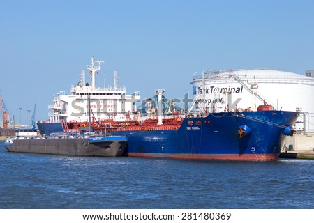 ANTWERP, BELGIUM - JULY 9: Oil tanker Port Russel moored near an oil silo in Port of Antwerp July 9,2013 in Antwerp, Belgium. The Port is the Europe\'s second largest sea port after Rotterdam.