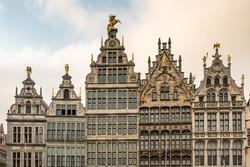 Antwerp, Facades of Guild buildings in the Grote Markt square in old town Cityscape under Golden Sky Sunset in Summer, Antwerpen, Belgium